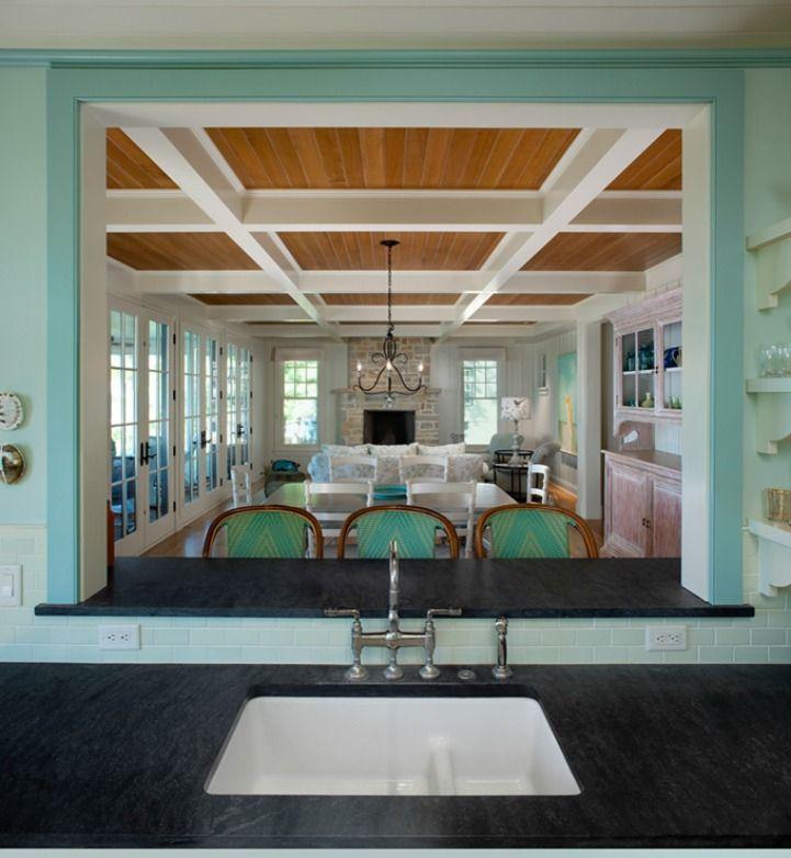 Bright aqua and white coastal kitchen and dining room