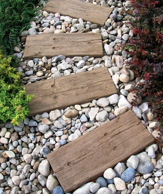 the pebbles combined with weathered planks create a distinctive walkway