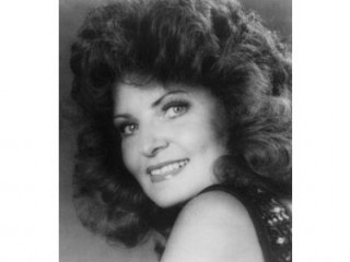 """Jeanne Pruett (January 30, 1937) is an American Country Music Singer and Grand Ole Opry star, best-known for her 1973 chart-topping Country hit, """"Satin Sheets"""", that spent 3 weeks at # 1. """"Satin Sheets"""" is her signature song. The song sounded much more Country than the songs that were coming out of Nashville at the time. When """"Satin Sheets"""" became a hit in 1973, Country music was moving more into Pop-oriented tunes yet """"Satin Sheets"""" wasn't just a Country hit, it was also a Top 40 Pop hit."""