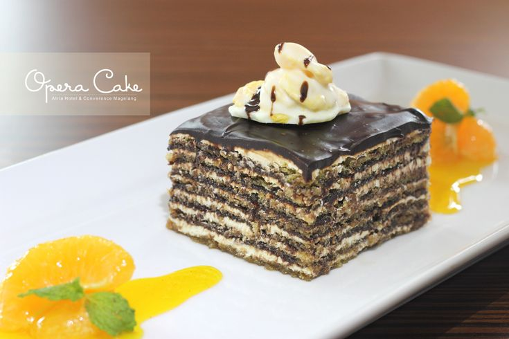 OPERA CAKE Layers of sponge cake soaked in coffee syrup, layered with  ganache and coffee butter cream, covered in a chocolate glaze