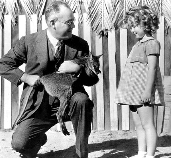Shirley Temple receives a wallaby from Fox Studios in Australia, 1935.