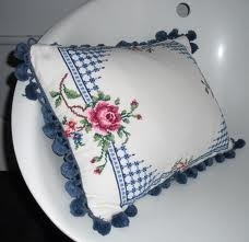Vintage cross stitch tablecloth made into a pillow.