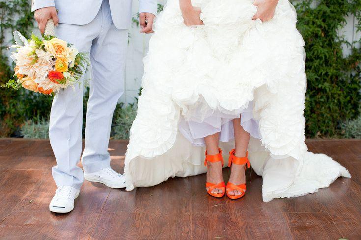hot orange wedding shoes | bride wears white wedding dress hot orange
