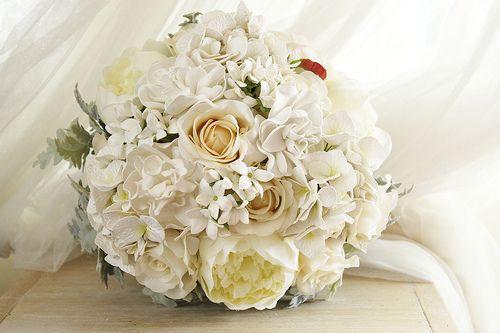 Sabine's bridal bouquet  Peonies, roses, gardenias, hydrangea, stephanotis and dusty miller.