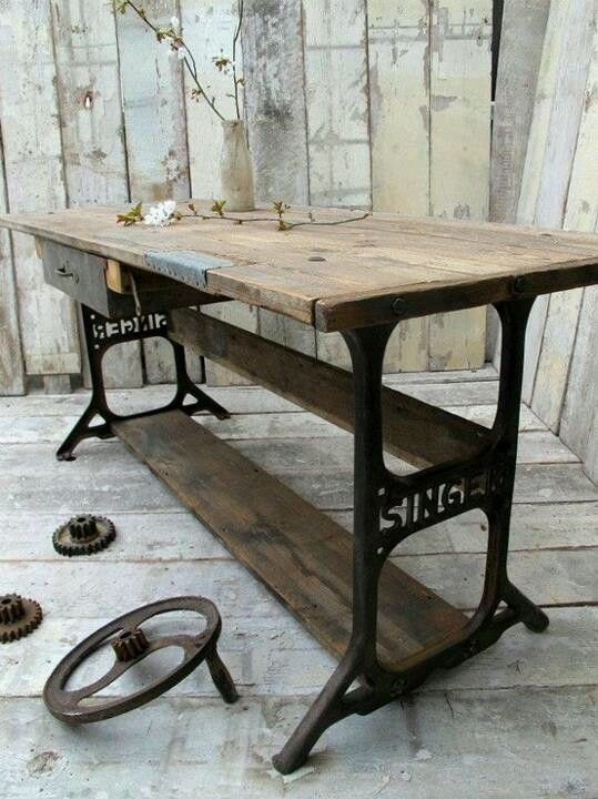LOVE IT....a table fashioned from an old Singer Sewing machine base :)