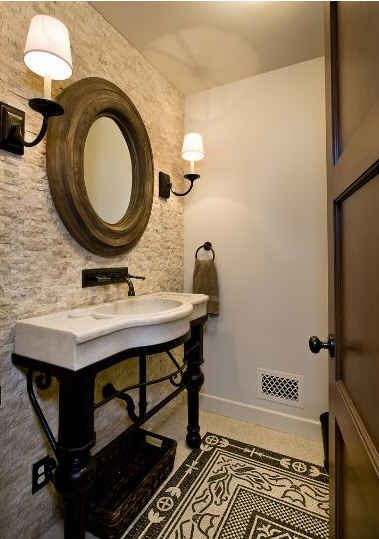 powder room with limestone wall. love the mirror and sink!