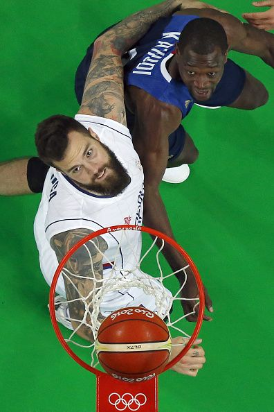 #RIO2016 An overview shows Serbia's centre Miroslav Raduljica and France's small forward Charles Kahudi eye a rebound during a Men's round Group A basketball...