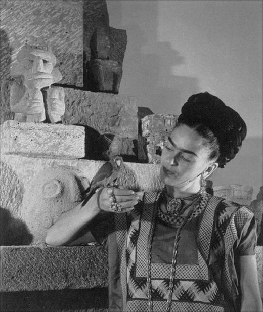 Frida Kahlo with a pet bird at Casa Azul, Mexico City, 1951