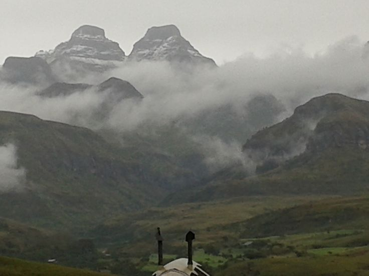 The clouds over Cathedral Peak, Drakensberg, as seen from the Didima wedding venue. A dramatic backdrop for a wedding.