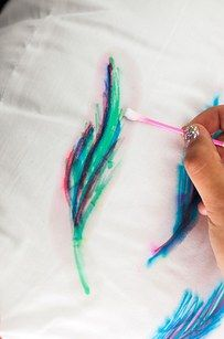 Watercolor-Inspired Throw Pillow with sharpie and rubbing alcohol| 17 Easy DIY Art Projects You Can Make With Watercolors