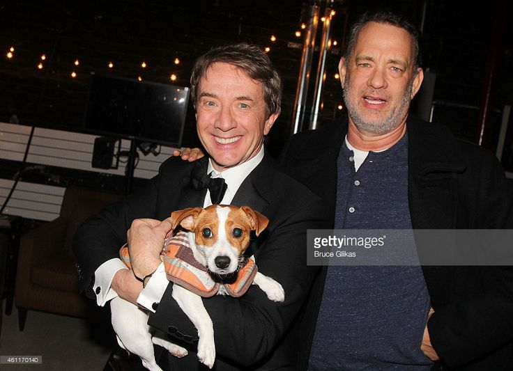 Martin Short and Tom Hanks pose with 'Grace' the dog backstage at the hit play 'It's Only A Play' on Broadway at The Schoenfeld Theater on January 7, 2015 in New York City.