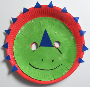 Styracosaurus mask  You will need:  Large paper plate  Small paper plate  Green paint  Red paint (or and other brigh colour)  Blue paper (or any othe bright colour)  Glue  Black pen  Elastic