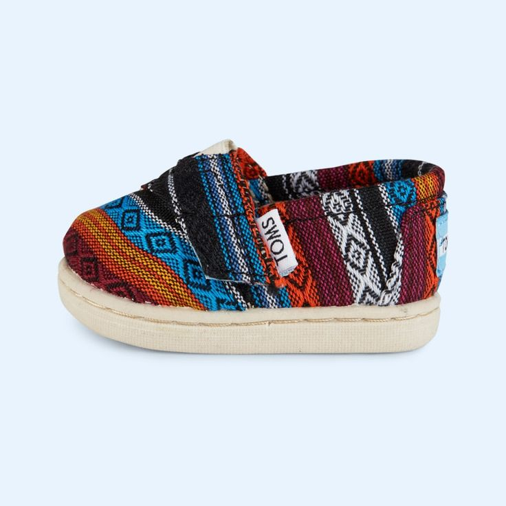 82517fc9489 The classic TOMS shoe in a cool woven fabric for your mini-me. Cute