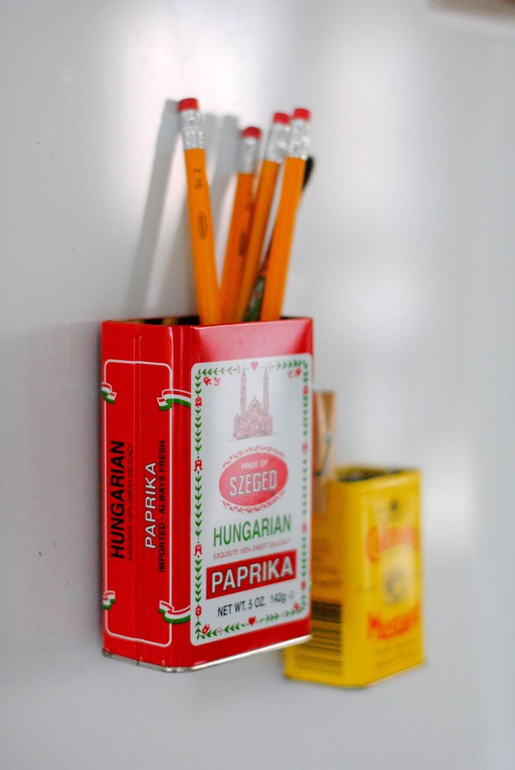 Give pretty spice or candy containers a new life in seconds by turning them into refrigerator magnets. Place a small, powerful magnet inside the back of an empty tin, which makes the tin itself magnetic. (Nonmetallic containers will work if you stick an adhesive magnet on the outside.) - Martha Stewart Living (coupons, notes, utensils, etc)