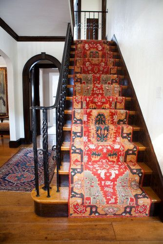 I LOVE the oriental carpet runner on these stairs.