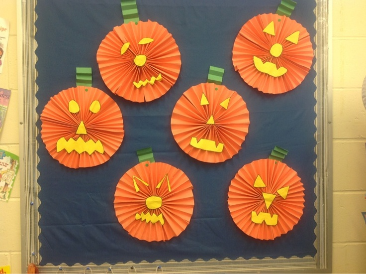 This is a Halloween craft I did with my grade four students. The circle is 4 pieces of construction paper fanned then folded in half and glued together.