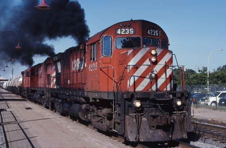 A trio of MLW's are in charge of CP 906 as they depart Beaconsfield after setting out a hotbox in August 1997