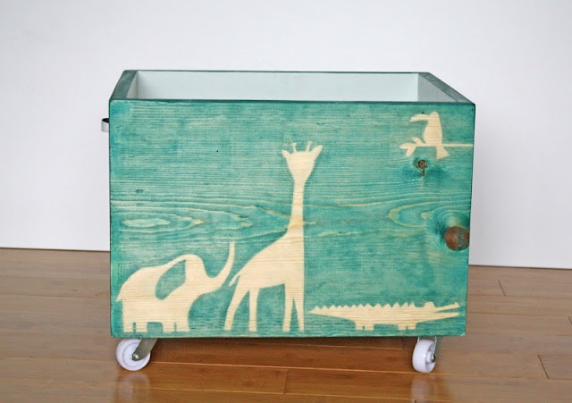 Tutorial: Building and staining a wooden crate with casters. Uses freezer paper for stencils.