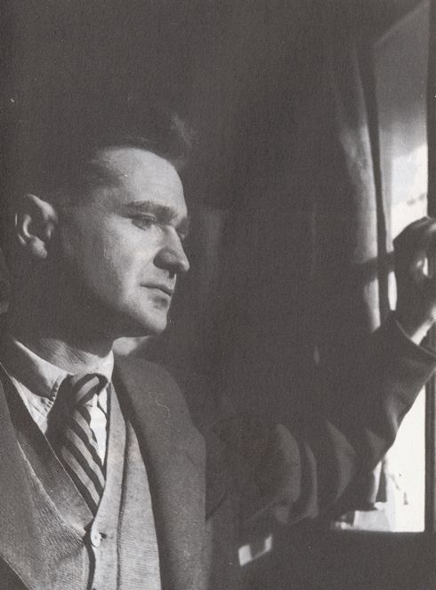 Emil Cioran (1911 - 1995), Romanian expatriate philosopher and aphorist, at his Paris window