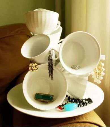 Speaking of jewelry holders, you can make a fun one using dollar-store tea cups and glue.