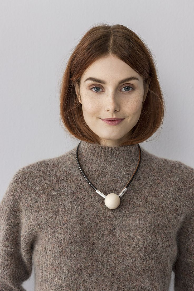 Seita is a necklace with a wood bead and leather designed by Pauliina Aarikka. www.aarikka.com