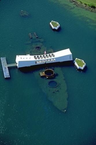 Pearl Harbor.... I would love to visit this memorial sight of American history.... I would want to stand there and just be zoned out for a while to feel sadness and horror that occurred below my feet..... throw a Hawaiian  flower necklace for all of the fallen soldier that was pushed to their suffering deaths... only for my respects