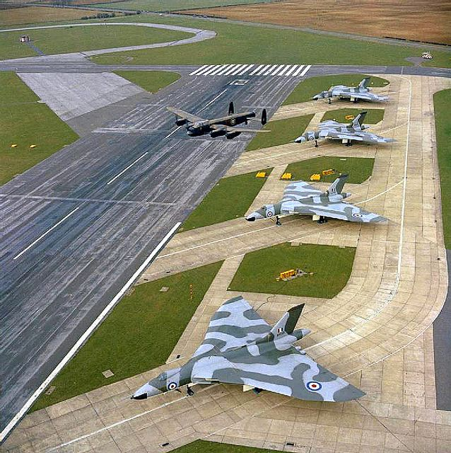 The last British Avro Lancaster in flying condition over Avro Vulcan B.2s of No 230 Operational Conversion Unit (OCU) on the Operational Readiness Platform at RAF Waddington, Lincolnshire.