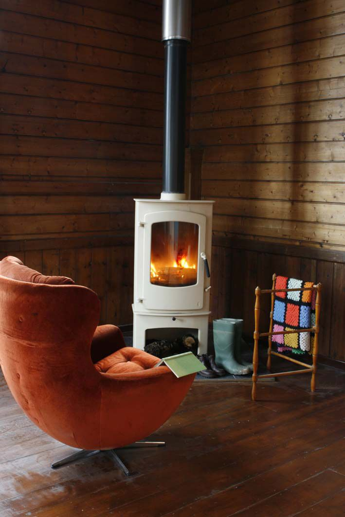 A wood-burning stove warms up chilly, rainy evenings. - 31 Best Corner Stoves Images On Pinterest