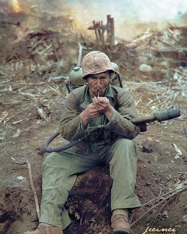 the_ww2_memoirs A US Marine with an M2-2 Flamethrower, lights his pipe while gallons of gasoline and nitrogen are strapped to his back, Iwo Jima,Febraury 1945. Marine flamethrowers were a vital part of the island hopping campaign during World War 2. When the Japanese began to use their Fakkuku tactics on islands such as Tarawa, the importance of flamethrowers became clearer than ever. The many bunkers and trenches on Tarawa were difficult to clear and costly but with a flamethrower it was…