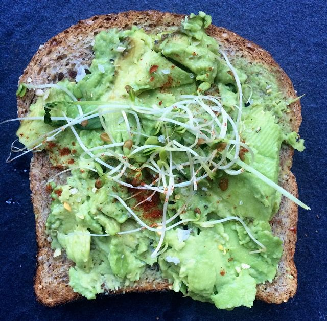 Warm Avocado Toast - Toasted bread is topped with creamy avocado and sprinkled with cayenne pepper for a filling breakfast or energizing afternoon snack that takes just two minutes to whip up. Give the toast a protein-boost by adding an egg or experiment with other veggie toppings like tomatoes, onions, sprouts, and radishes.