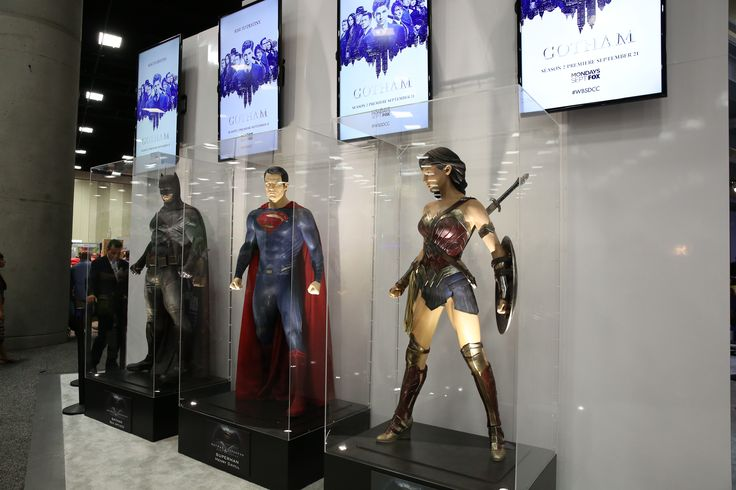 Batman, Superman and Wonder Woman mannequins in the Warner Bros. booth at Comic-Con 2015. #WBSDCC (©2015 WBEI. All rights reserved.)