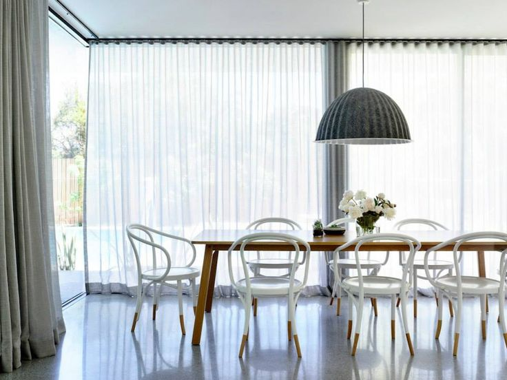 Jardan Navy Table & Thonet footed chairs.  Perfect combination.   Image via McKimm Design.  Photographer Derek Swalwell.  Styled by Heather Nette King.