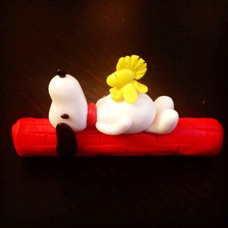 Snoopy and Woodstock taking a nap on a Cuchufly