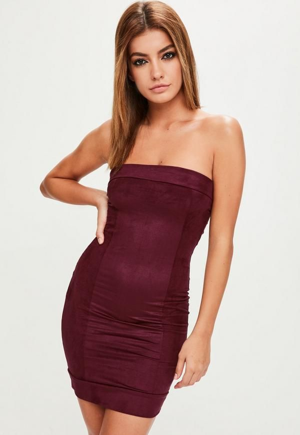 Burgundy bodycon dress featuring a bandeau neckline, faux suede fabric and exposed seam details.