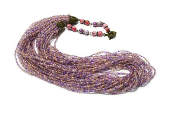 This unique purple and pink seed bead necklace delightful in its simplicity. This delicate and romantic necklace will adorn any girl and woman. It is easy, elegant jewelry suitable for everyday use and special occasions. Is handmade especially for you.  ◆MEASUREMENTS Length 29.13 inch ( 74cm ) Weight 0.25 lb ( 114g )  Each purchase comes carefully packaged.  ◆Please note that real colors may slightly differ from their appearance on your display  Thank you for visiting my shop!  Please visit…