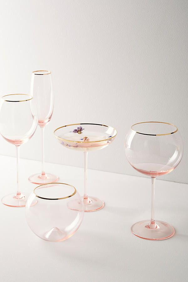 In this glassware set, the eye-catching gold rims pair beautifully with asubtle pink hue.Smaller than most other glasses, the Coupe is our favorite: it's perfect for small doses of potent cocktails served
