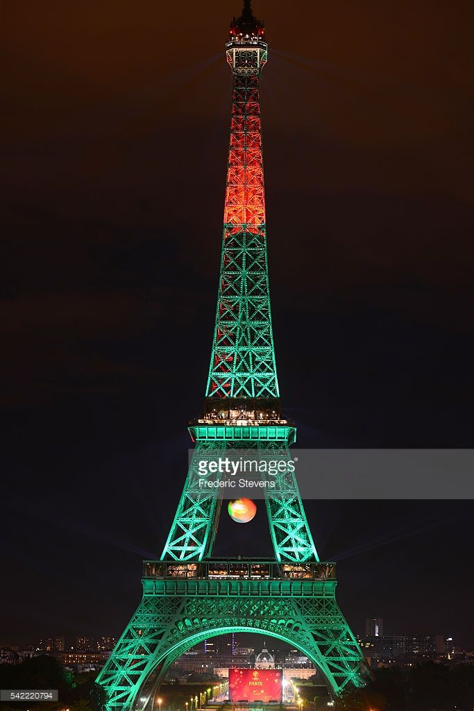 #EURO2016 PARIS, FRANCE - JUNE 22: The Eiffel tower is lit up in the colors representing Portugal for the 'EURO 2016' Twitter contest organized by French telecom operator 'Orange' at Eiffel Tower on June 22, 2016 in Paris, France.