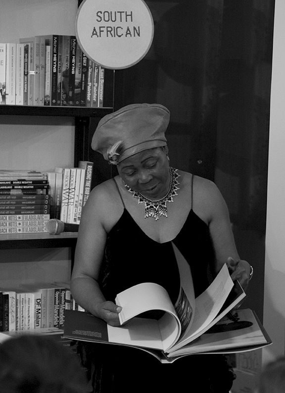 Gcina Mhlophe peruses 21 Icons' Season I coffee-table book.