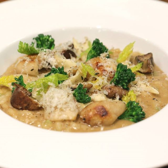 While it may sound counterintuitive, you can actually bring a vegetarian to a steakhouse-ours at least. Meat (and gluten!) free risotto with crisp broccolini, mushrooms and truffled pecorino.