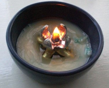 simple little oil lamp specially designed to burn fuels that are solid at room temperatures