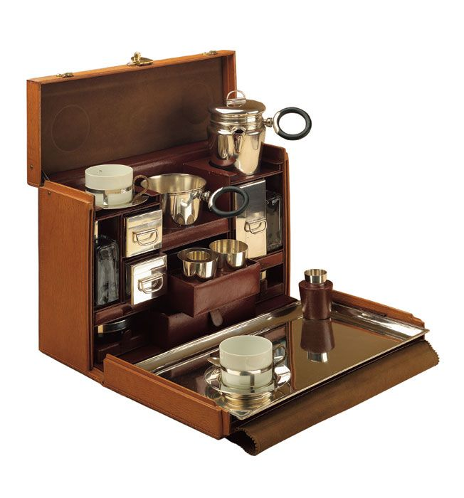 This is the ultimate tea case for a stylish picnic or safari! Style Court: Tea case Louis Vuitton Paris, 1926; Leather with silver, ceramic and glass; Collection Louis Vuitton