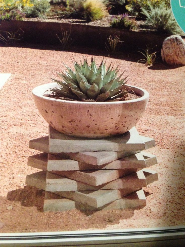 Great raised planter made by stacking square pavers