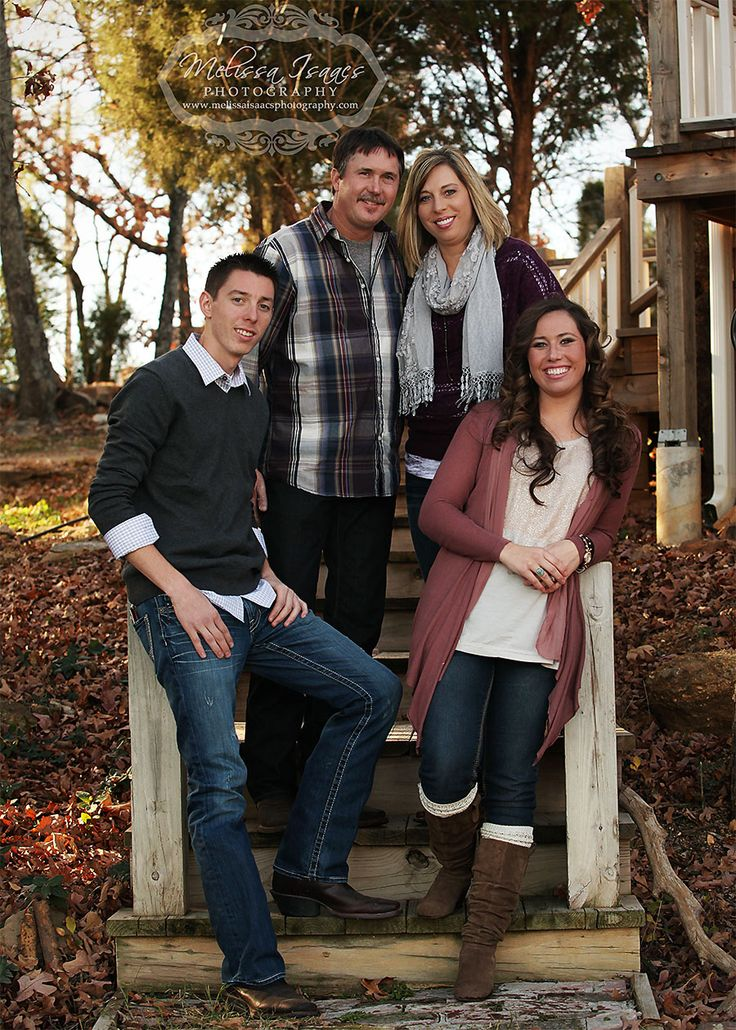 The lighting could be better, but I like the idea of using stairs to set up the shot. Family of four with teens.