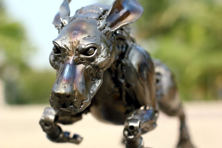 The rocket dog metal artwork made of recycled metal for Dog wire art