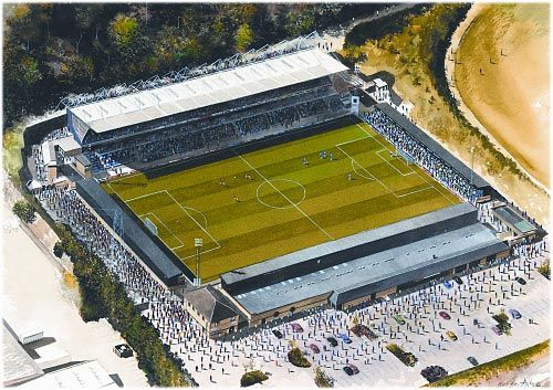Painting of The Causeway Stadium (Now the Adams Stadium), home of Wycombe Wanderers Footbal Club and the London Wasps (1990 to present); currently in the English League Two. Location; Buckinghamshire, South Central England; ground capacity: 10,000.  If you would like to buy the original artwork of this image, please contact us.
