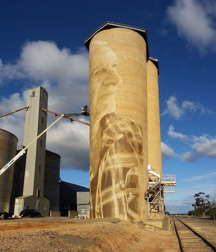 Rone's silo depicts the faces of Lascelles couple, Geoff and Merrilyn Horman, whose families have lived and farmed in the area for four generations.  Born in the district, the couple married in Lascelles in 1967 and together with their two sons (and their own families) have continued the family traditions of wheat farming, hard graft and strong community involvement.   So how did the humble country couple come to be chosen as subjects of a large-scale mural by one of Australia's leading…