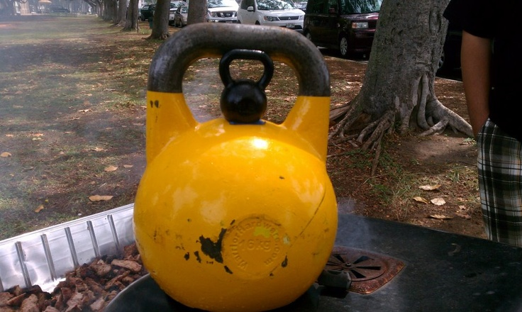 Baby kettlebell sitting atop a competition 16kg Kettlebell.
