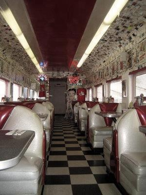 The Rock and Roll diner in Pismo Beach, CA is housed inside two long train cars attached to form one long restaurant. It is decorated l 50's style with little juke boxes at each booth.