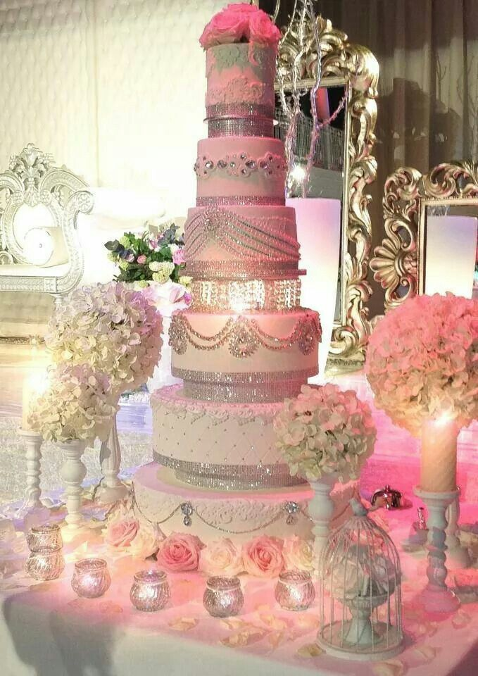 Gorgeous Lighting on this Wedding Cake Table! This 6 Layer Cake offers a different design on each!
