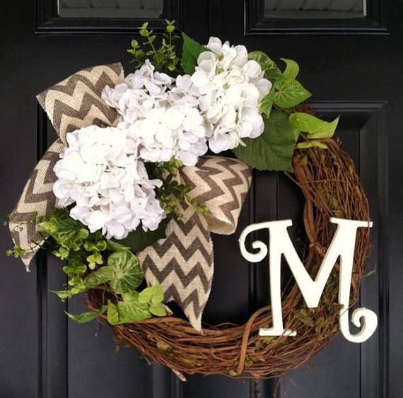 this gorgeous wreath is neutral enough for any style home and any color door :) this wreath can be put up now and stay up until fall !! made on a 18